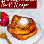 the best french toast stacked on a white plate with butter melting on top and strawberries