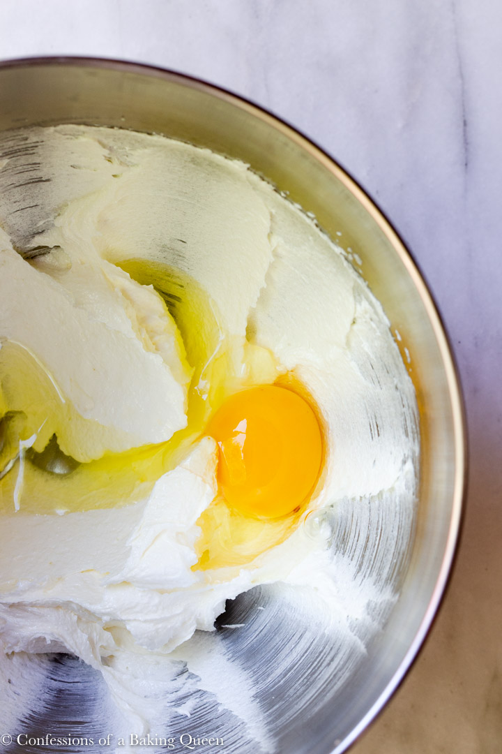 egg added to mixing bowl of butter and sugar