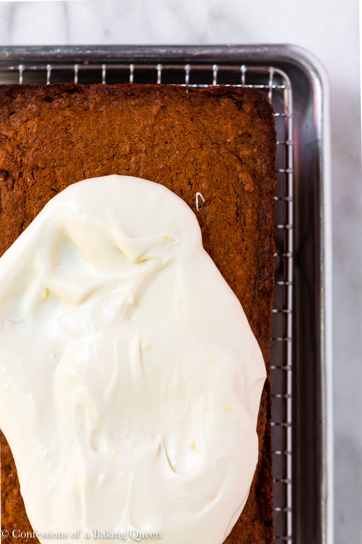 cream cheese frosting spread on top of a Gingerbread Loaf Recipe