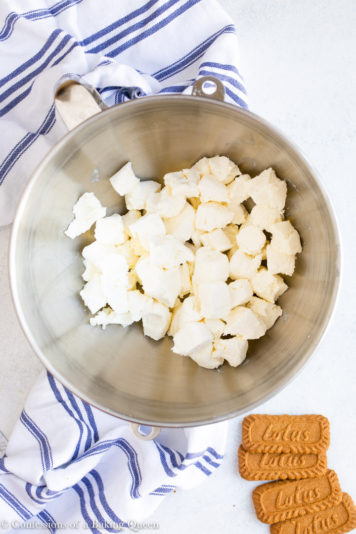 cubes of cream cheese in a metal mixing bowl