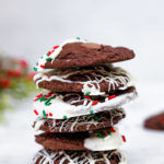 Chocolate Peppermint Cookies stacked high on a marble surface