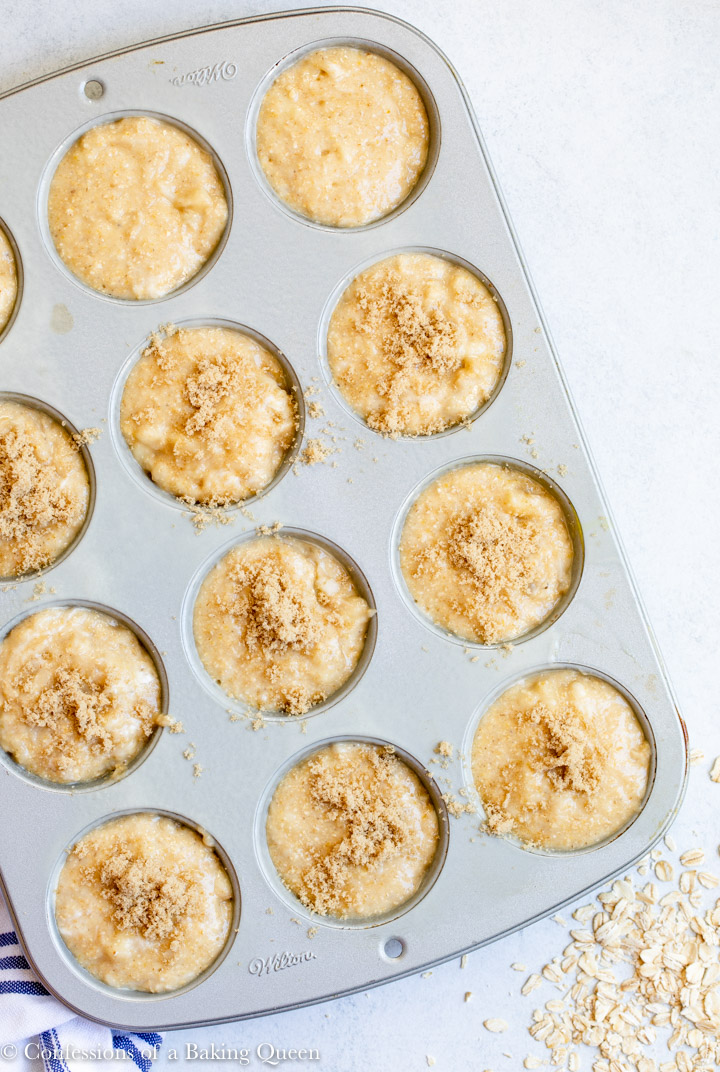 brown sugar sprinkled on top of an oat flour banana muffin recipe