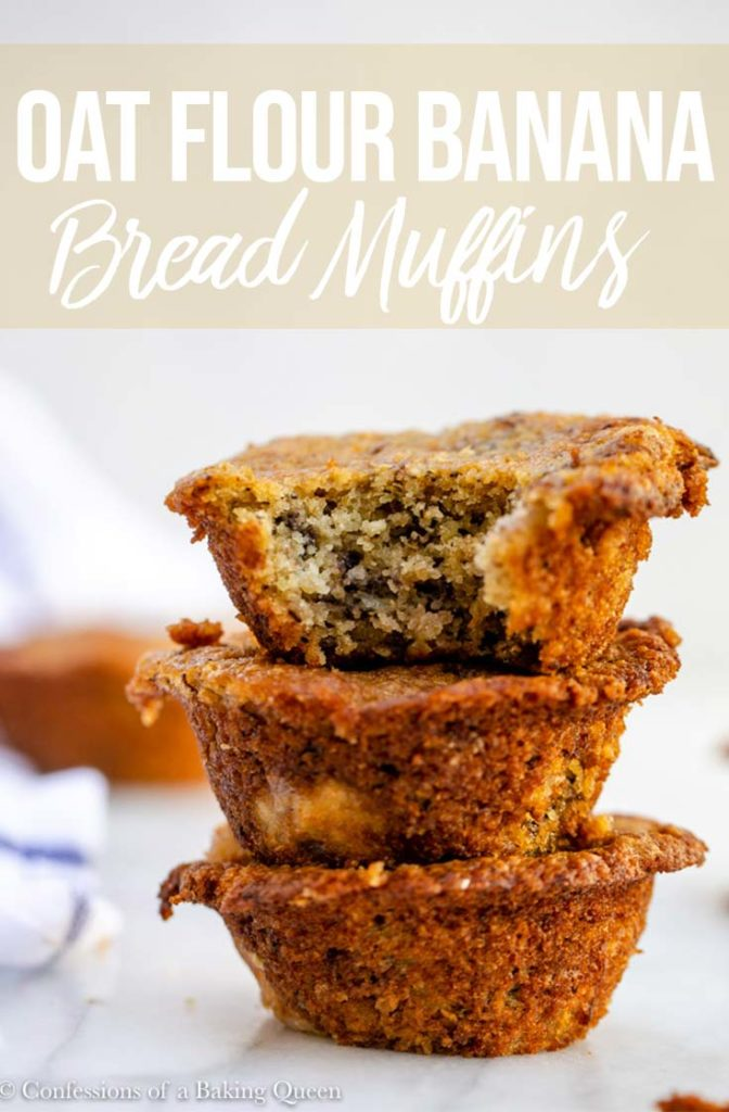 oat flour banana bread muffins stacked on top of each other on a white marble surface