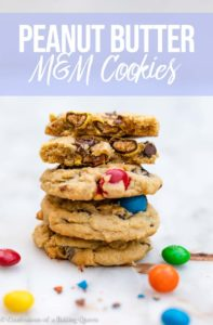 medium high stack of peanut butter m&m cookies