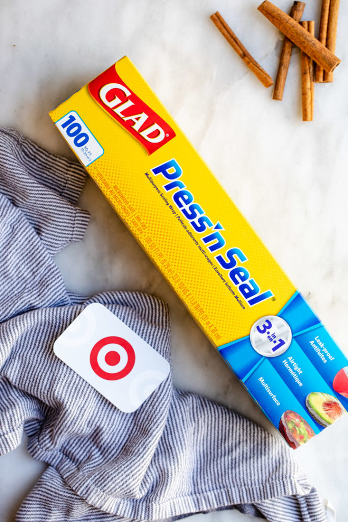 box of glad press n seal with a target gift card on a white surface with a white and blue linen