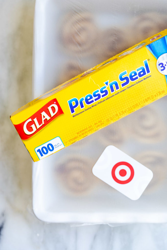 glad press n seal and target gift card on top of a dish with cinnamon rolls in on a white surface