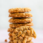 butterscotch oatmeal cookies baked and stacked on a pink surface