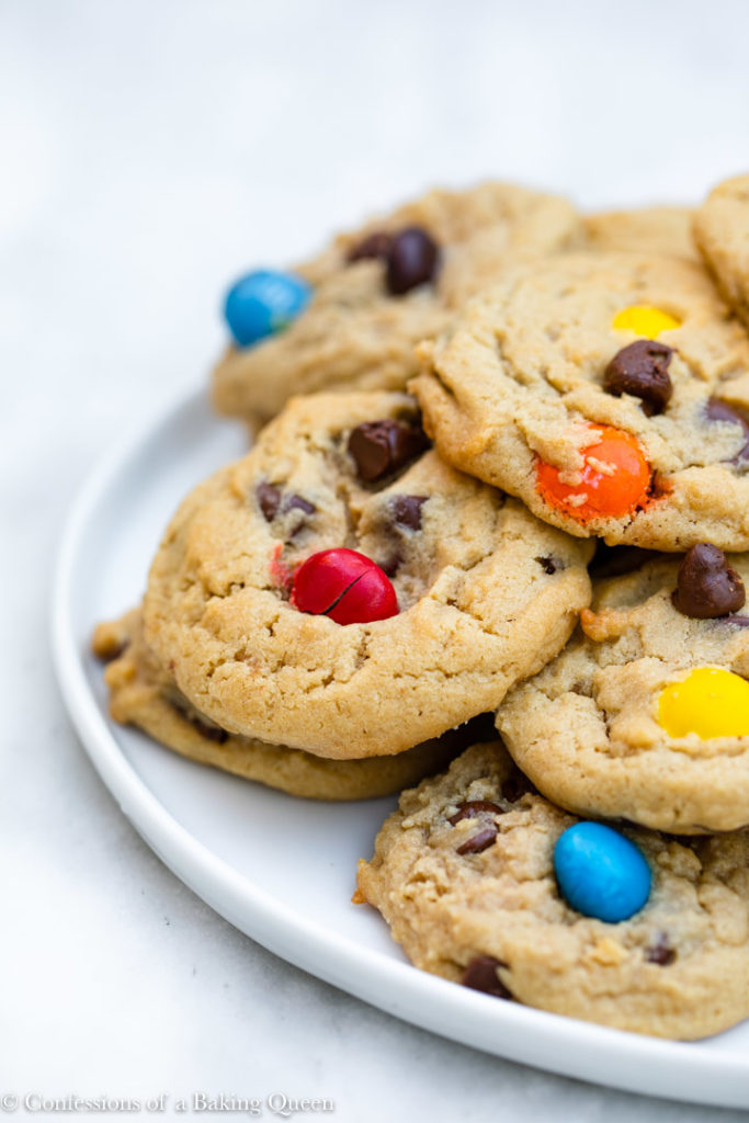 white plate full of peanut butter m&m cookies on a white surface