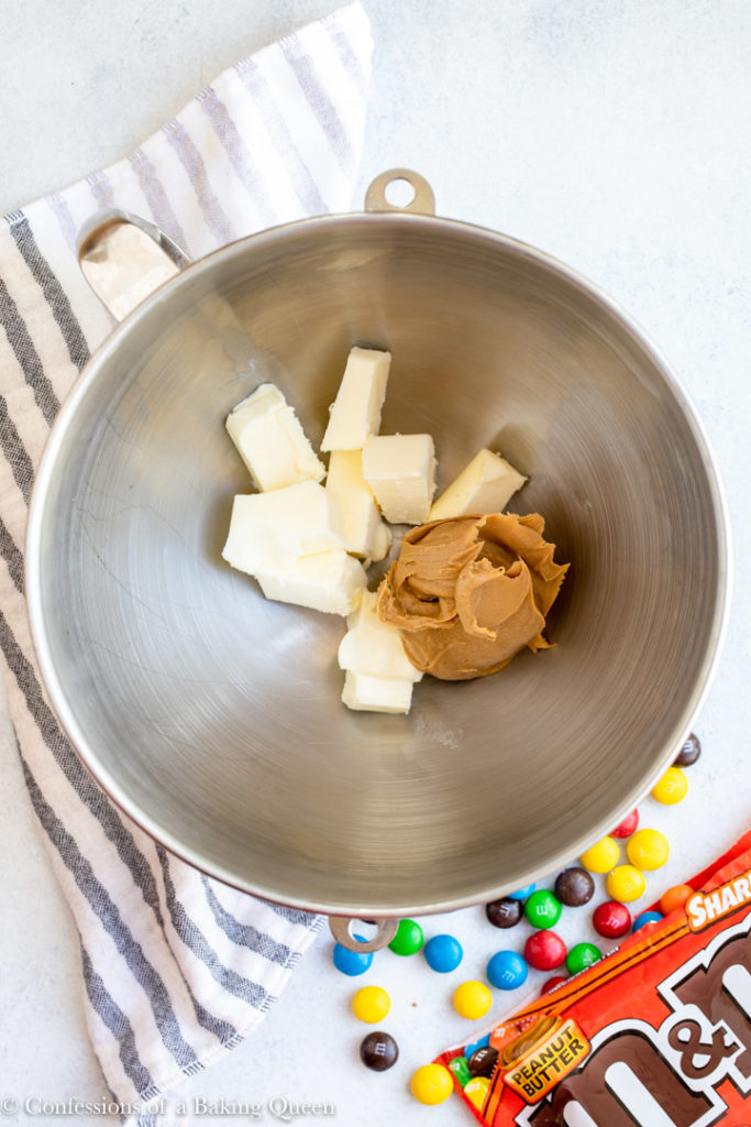 butter and peanut butter in a metal mixing bowl