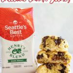 chocolate chunk scones stacked high on top of each other next to a bag of seattles best coffee