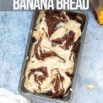 chocolate swirled into banana bread batter on a grey background