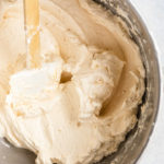 close up of baileys Swiss meringue buttercream recipe in an metal bowl