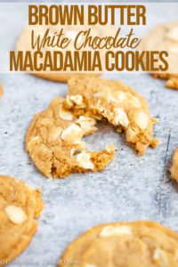 a broken brown butter white chocolate macadamia cookies on a gray blue surface