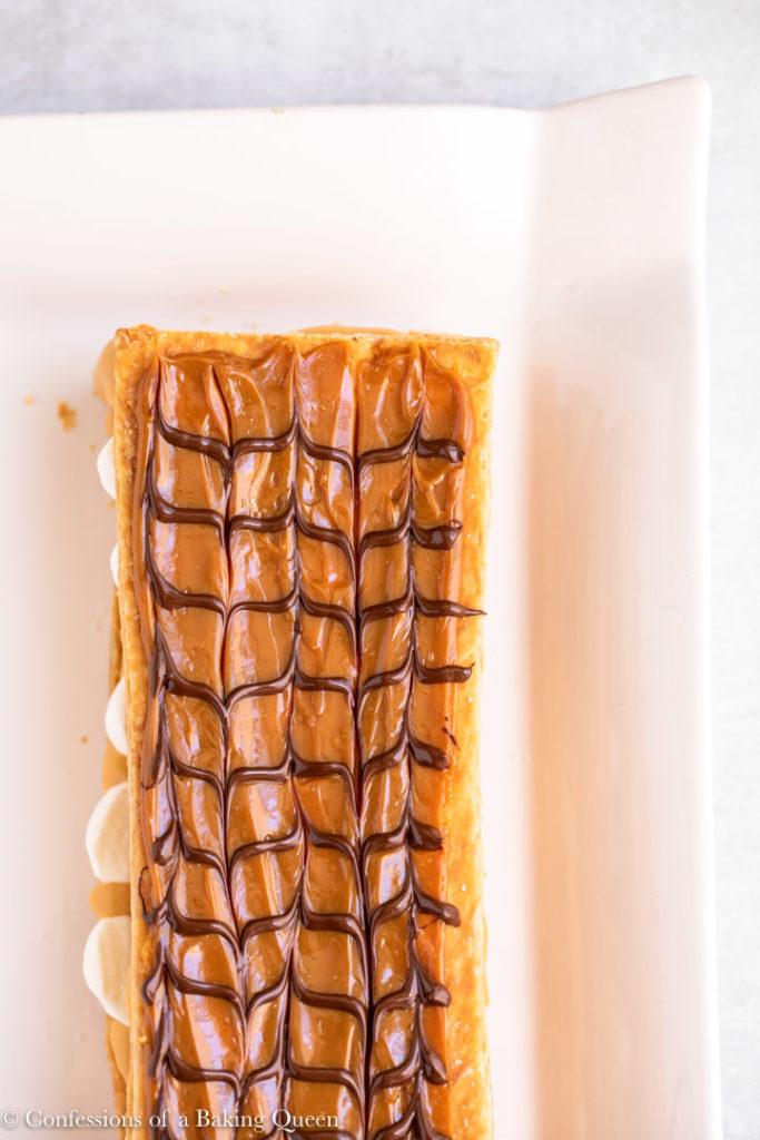 dulce de leche napoleon on a white plate
