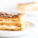 slices of dulce de leche millie feuille on round plates