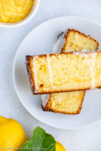 lemon curd lemon loaf cake stacked on top of each other on a white plate