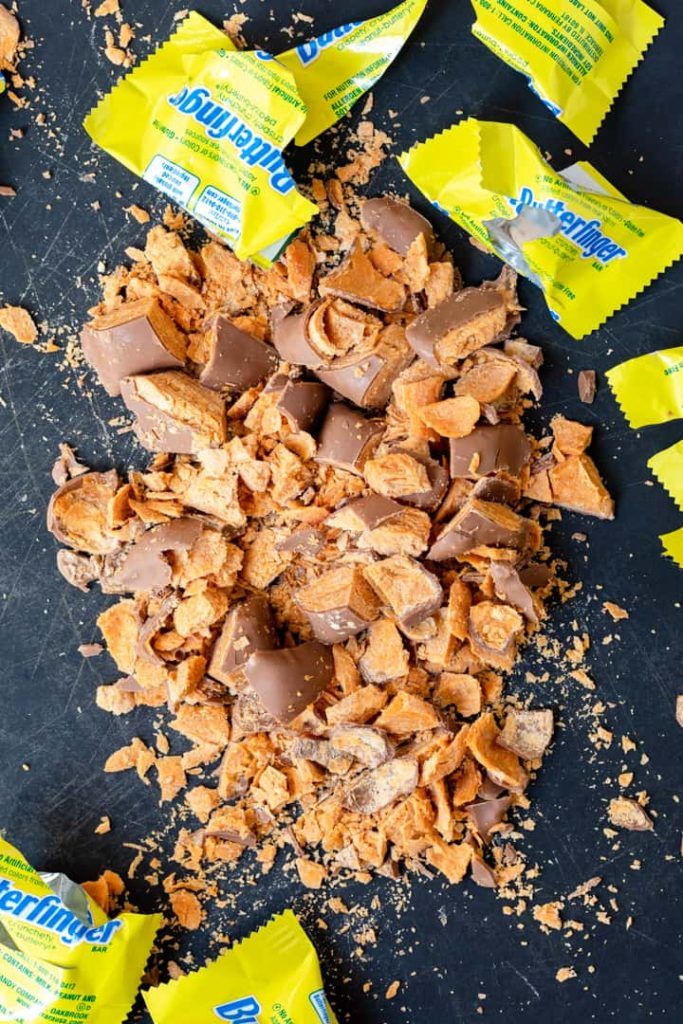 chopped butterfingers on a black cutting board