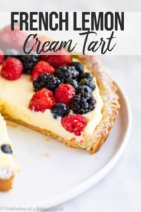 close up of a berry topped french lemon cream tart