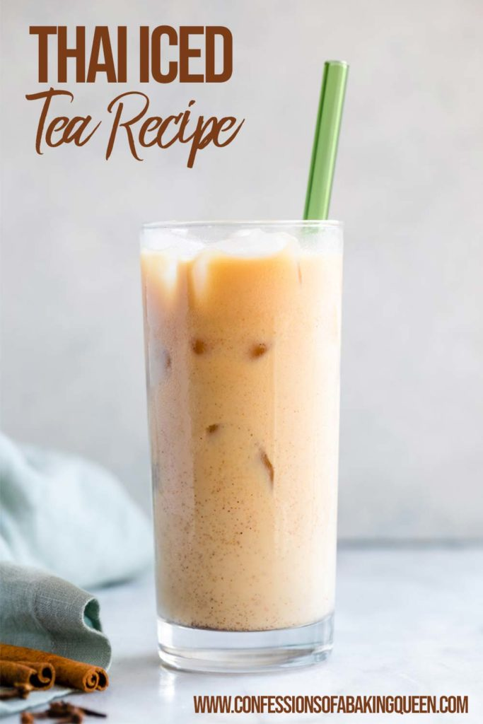 glass of thai iced tea on a white counter