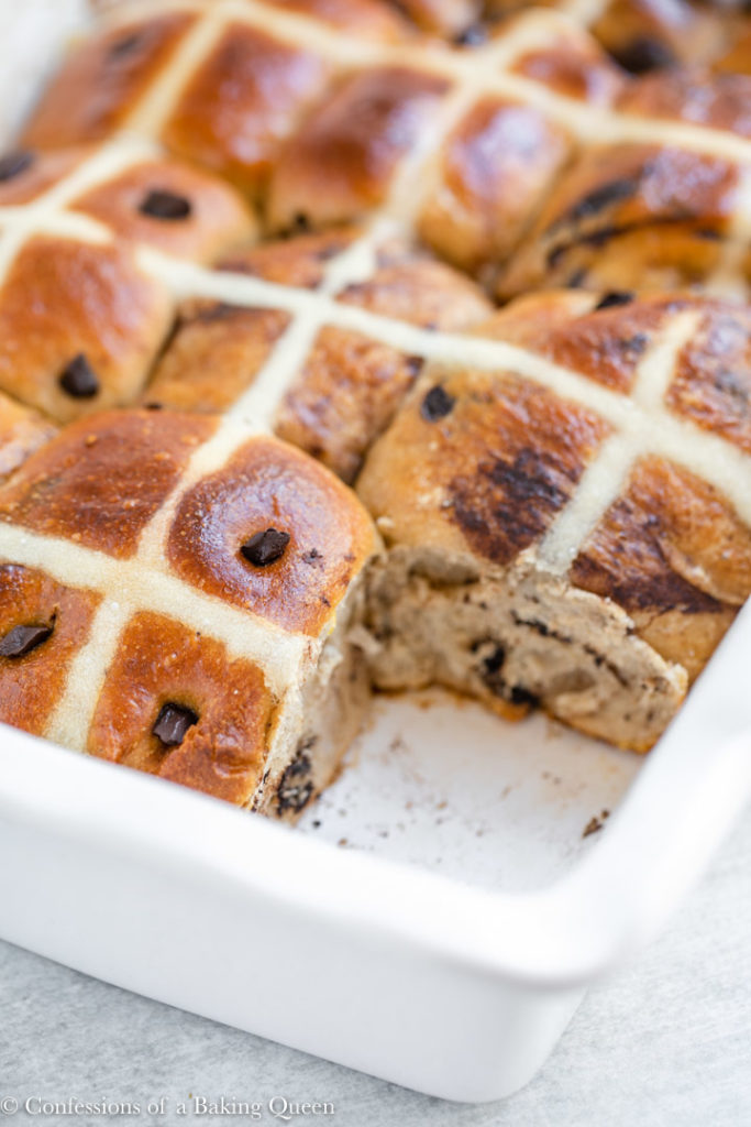 chocolate hot cross buns in a ceramic dish