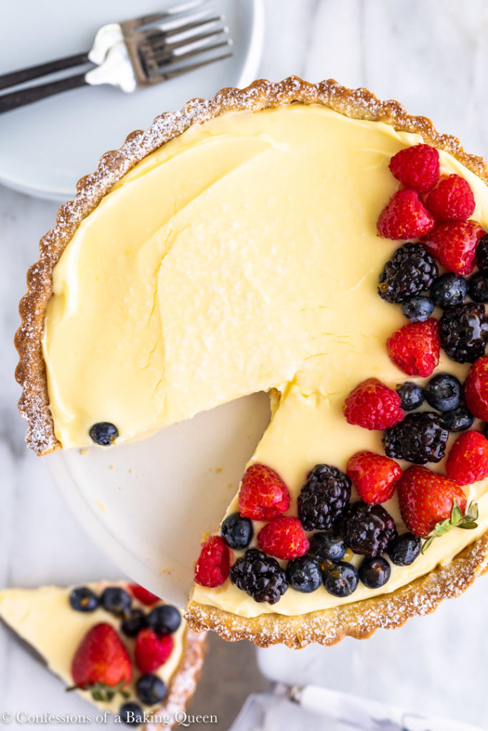 french lemon cream tart with a slice cut out