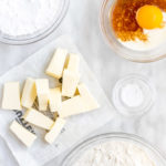 ingredients for sweet shorrcrust pastry on a white marble surface