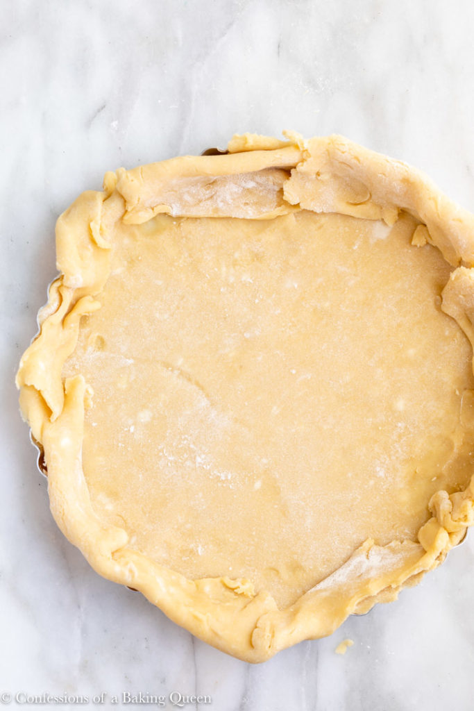sweet crust pastry dough in a tart tin