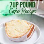 slice of 7up pound cake on a white plate next to the whole cake