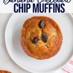 one banana chocolate chip muffin on a white round plate