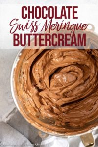 chocolate swiss meringue buttercream mixed in a metal bowl
