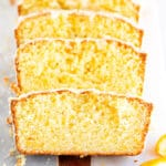 close up of orange loaf cake recipe on a white surface