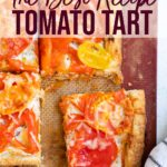 tomato tart cut into pieces on a silpat lined baking sheet