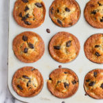 banana chocolate chip muffins in a silver muffin tin