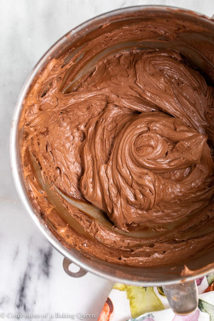 chocolate cream cheese frosting in a large metal mixing bowl