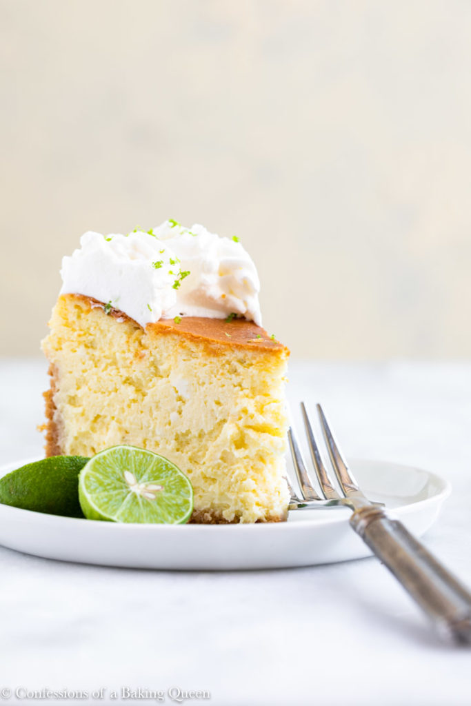 fork next to a slice of key lime cheesecake