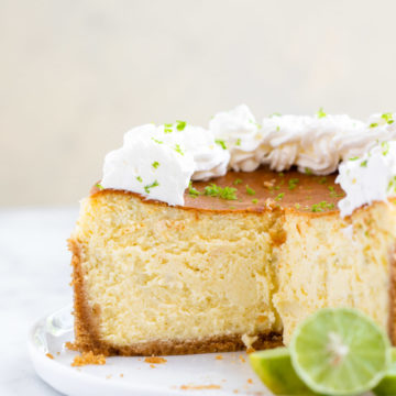 inside view of key lime cheesecake sitting on a white plate