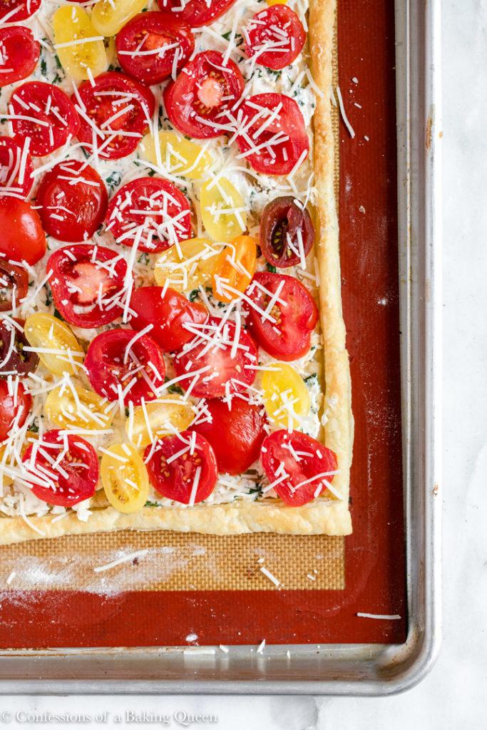 tomato tart on a silpat liner before baking