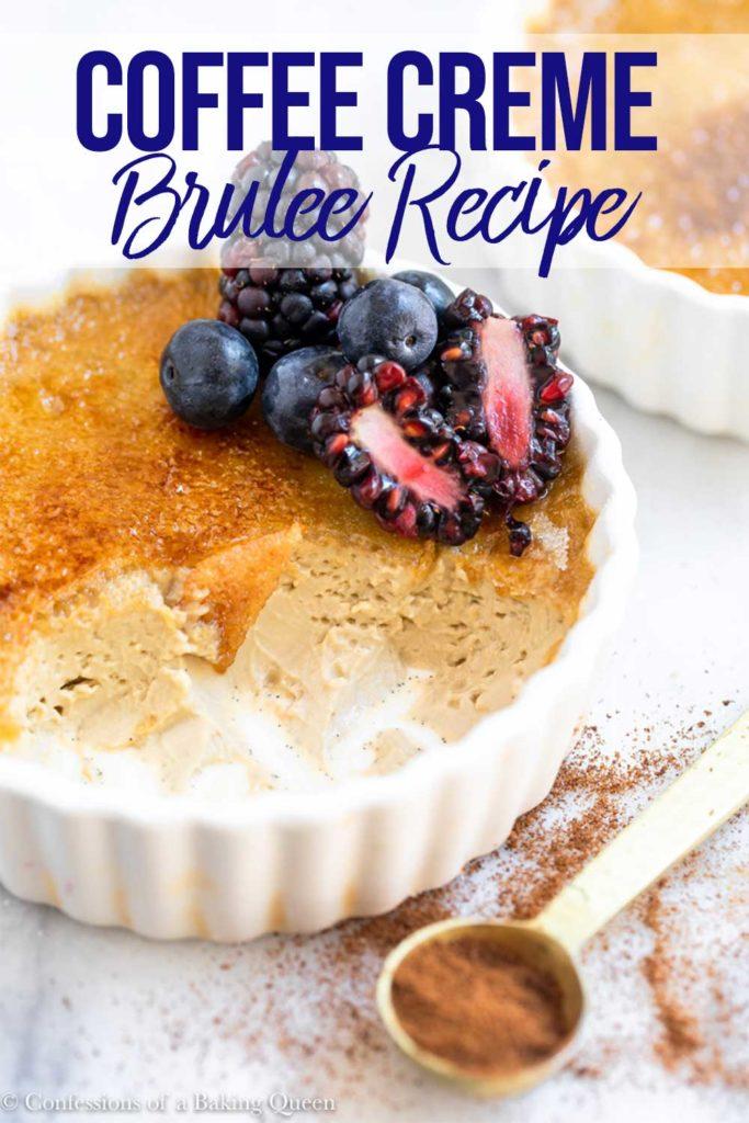 blueberries and blackberries on top of a half eaten coffee creme brulee