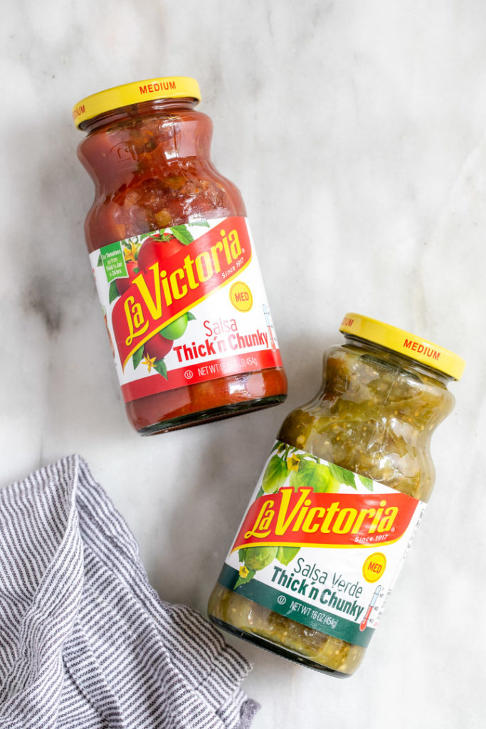 la victoria salsa and verde salsa on a white surface