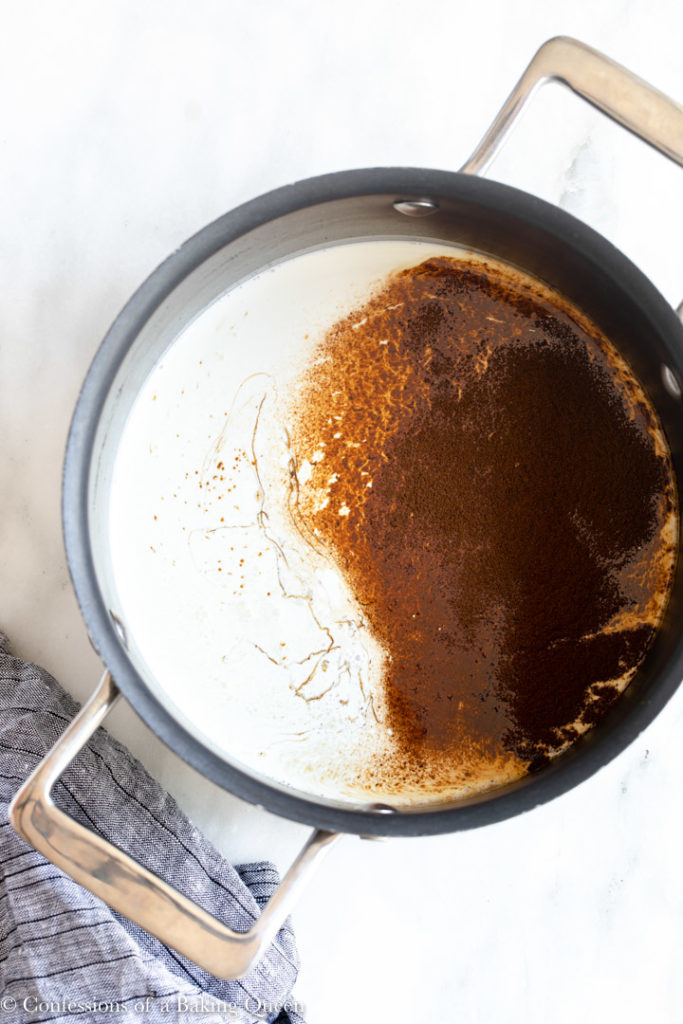 heavy cream with espresso powder and vanilla bean paste in a large pot