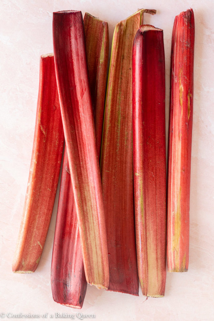 rhubarb stalks on a pink background