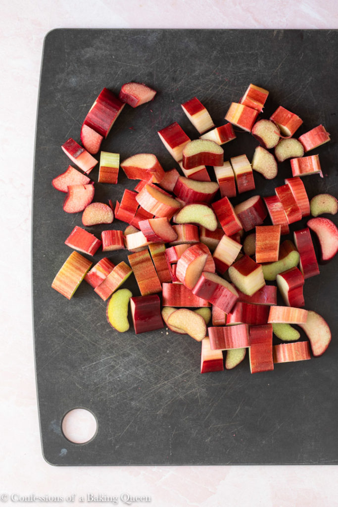 chopped rhubarb on a black cutting board