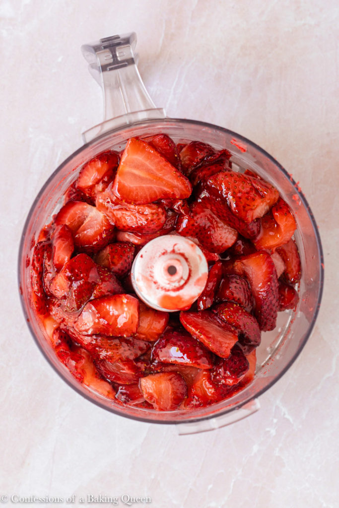roasted strawberries in a small food processor bowl