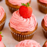 strawberry cupcakes on a pink background