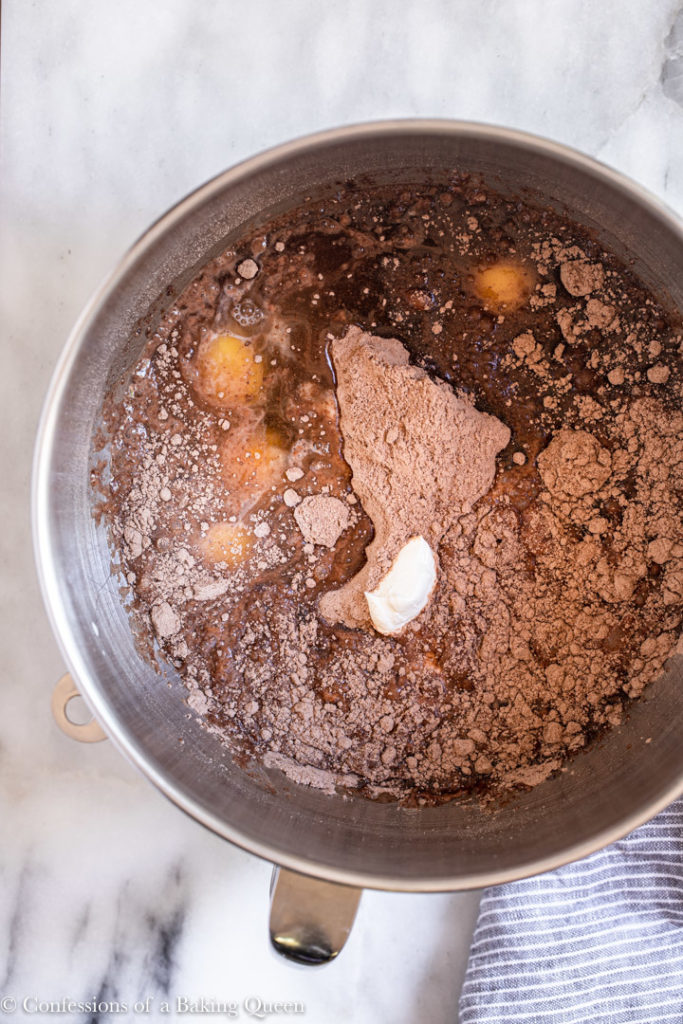 chocolate cake mix, eggs, sour cream, and oil in a metal mixing bowl