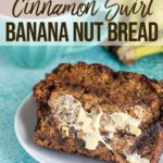 cinnamon swirl banana nut bread with butter on a white plate