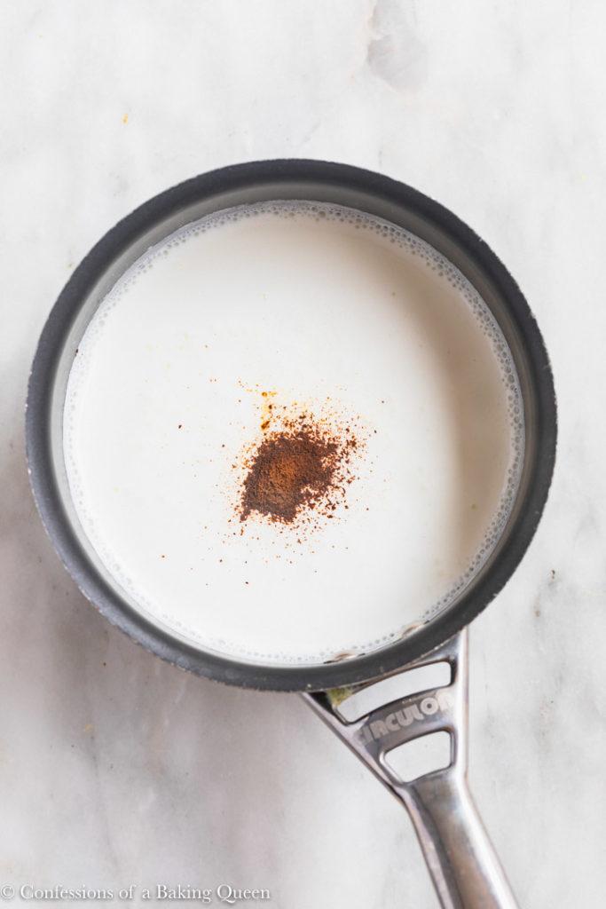 half and half and espresso powder in a small pot