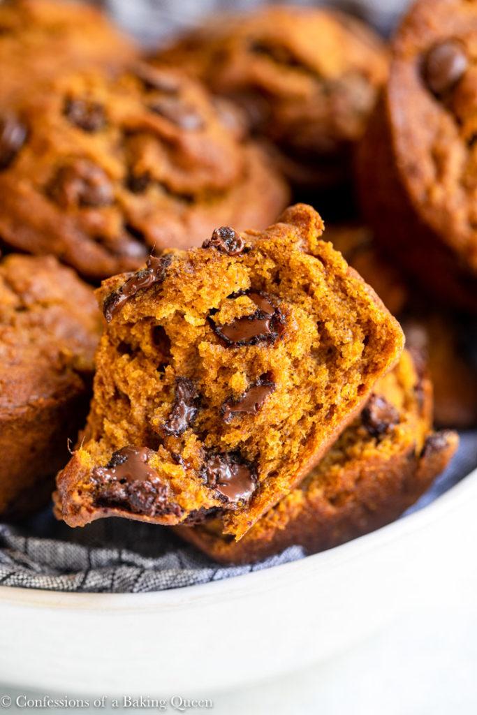 close up of a broken chocolate chip pumpkin muffin