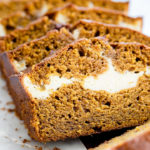close up of pumpkin cream cheese bread on a marble surface