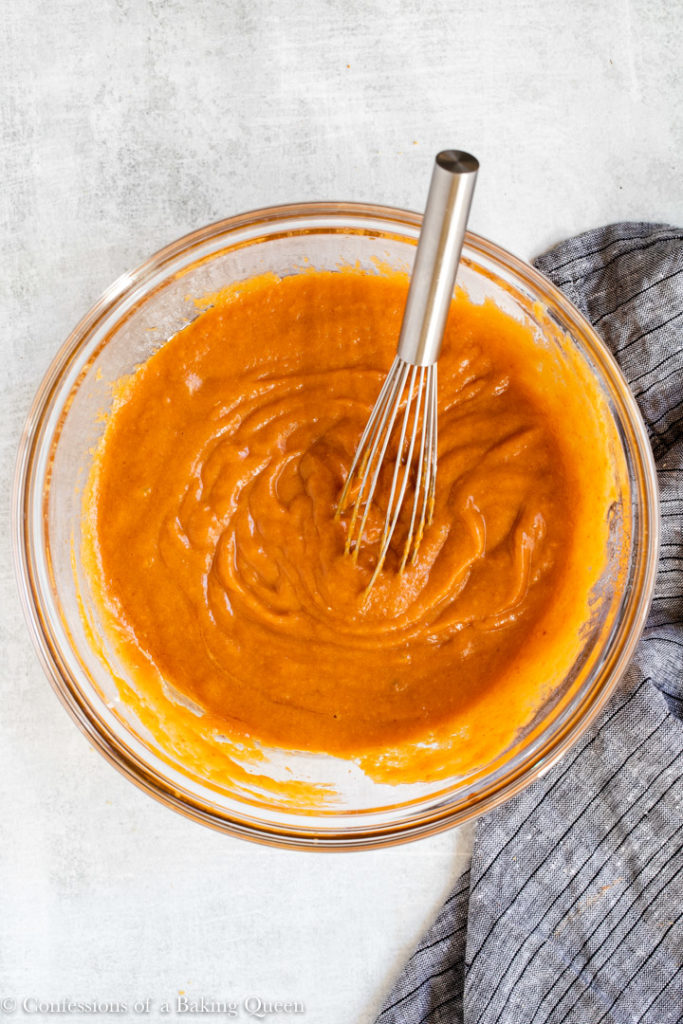 wet ingredients mixed together in a glass bowl for a pumpkin cream cheese bread